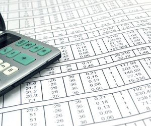 numbers on paper and calculator microsoft offers excel users free billing