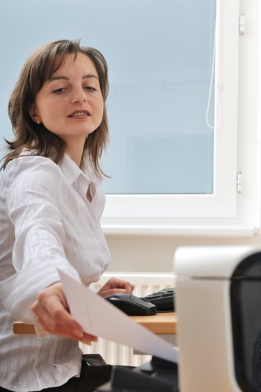 Business person working with printer