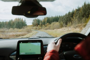 Man uses navigational system for driving directions