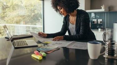 Female designer working at home office on new ideas