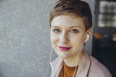 Portrait of woman with earphones