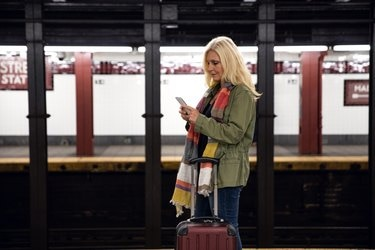Woman in waiting for the train in the city