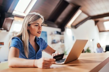 Close-up image of beautiful blonde woman shopping online.
