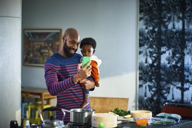 Man with baby son (6-11 months) at home