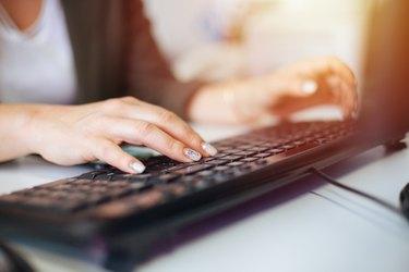 Businesswoman using desktop PC at office
