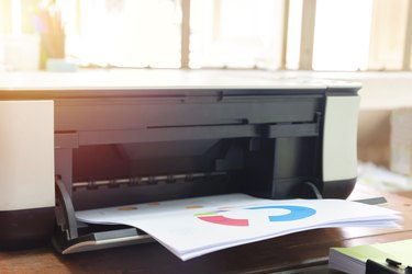 Using the printer. It is an important device in the office.