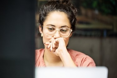 Thoughtful businesswoman using computer in office