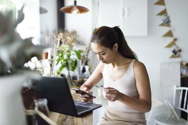 Beautiful woman online shopping in a cafe