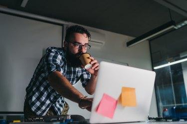 Engineer drinks coffee at work