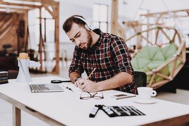 Creative Worker. Listen Music. Working. Ideas.