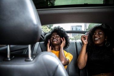 Afro girls having fun in the car
