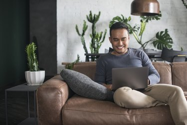 Young Asian man working at home.