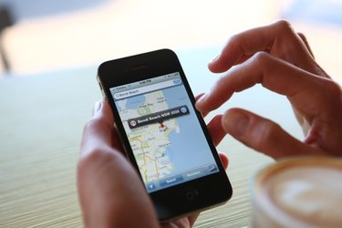 Woman Using Google Maps On Her iPhone