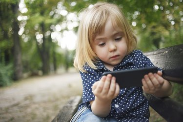Little child using smart phone