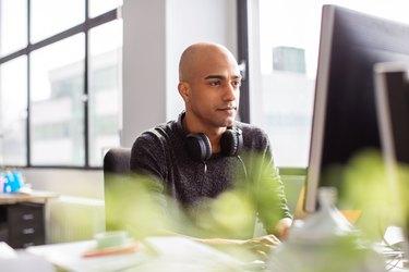 Business man working on desktop pc in office