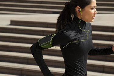 Woman exercising with earbuds