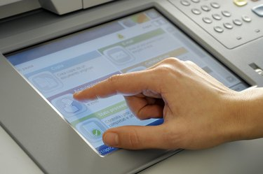 hand on touchscreen