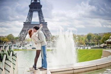 Loving couple kissing near the Eiffel Tower in Paris