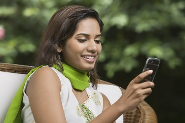 Smiling woman using cellular phone