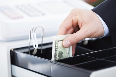 Hand With Dollar Notes