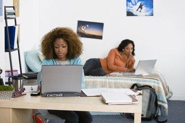 Women using laptop computers