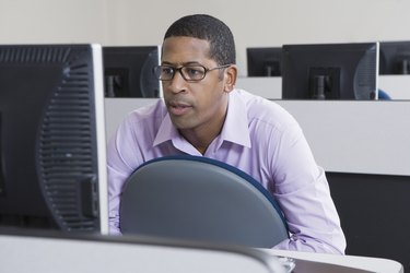 Serious African American Businessman Working on Computer