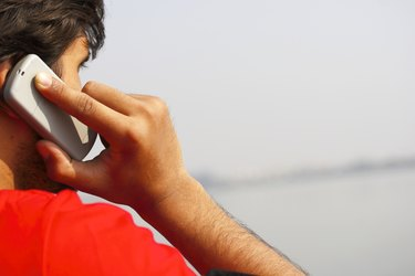 Close up shot of a man talking on cell phone