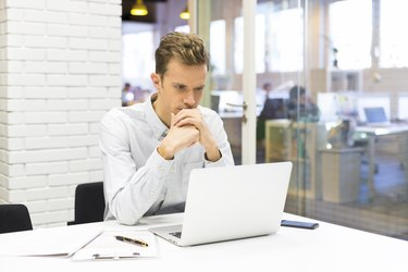 Man working on his laptop at the office in startup