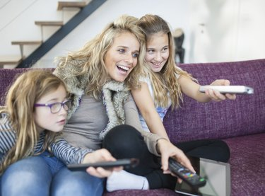 Family changing channels on the television