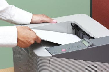 Businessman working with printer