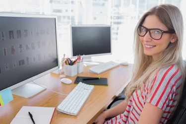 Attractive photo editor working on computer