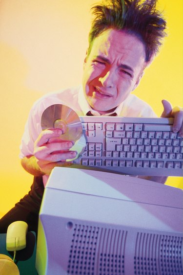 Frustrated businessman with computer