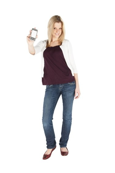 Woman posing with smartphone