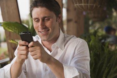 Smiling man using PDA