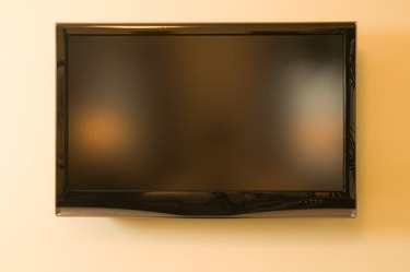 Television hanging on wall