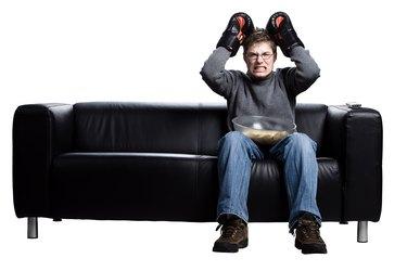 Man watching boxing on TV