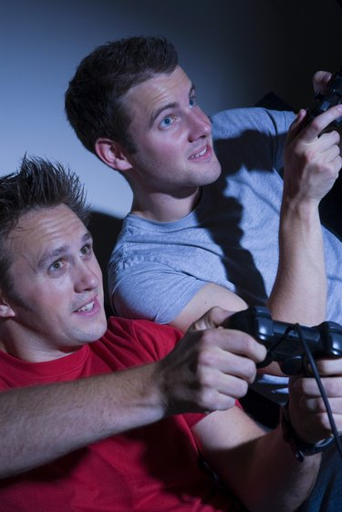 Two men playing on a games console