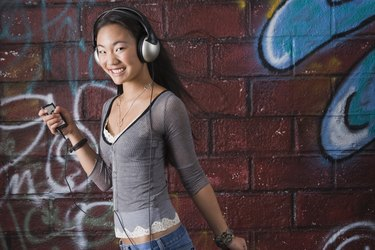 Teenage girl with media player