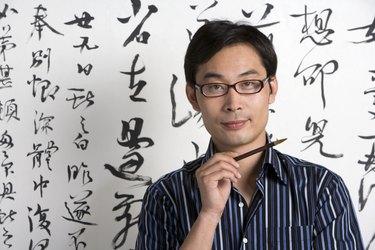 Chinese artist holding paintbrush