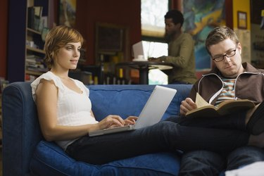Couple reading together on couch