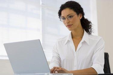 Businesswoman using laptop computer