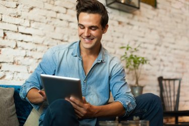 Casual Man Using Tablet Computer Smile