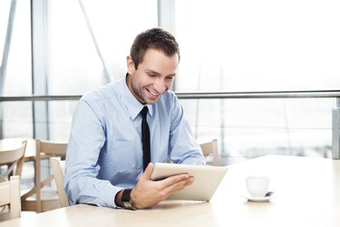 Businessman with digital tablet smiling