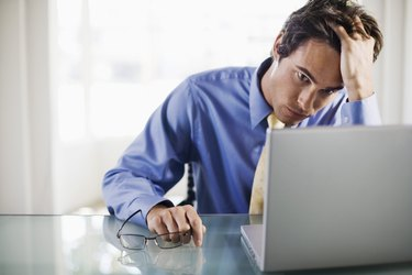 Frustrated businessman with laptop computer