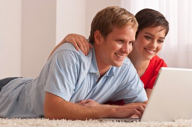 Couple relaxing with laptop
