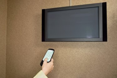Woman using flat panel television