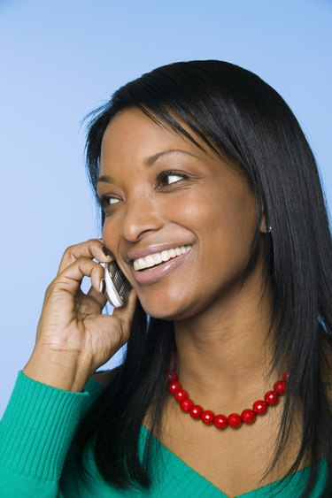 Cheerful woman on cell phone