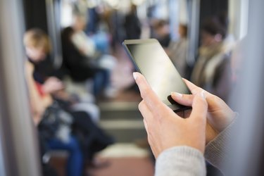 Woman using her Smart phone in Subway