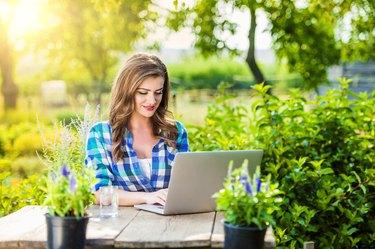 Beautiful young woman gardening