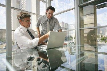 Businessmen using a laptop
